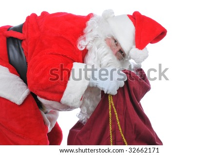 Santa Bent over and Looking in His Bag for more toys isolated on white - stock photo