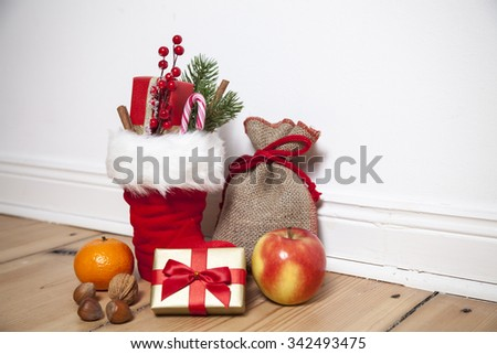Santa Boots (St. Nikolaus) on wooden floor, vignette - stock photo
