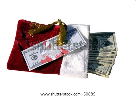 Santa Bucks on top of a red gift bag stuffed with MONEY!!!!!!!!!!! - stock photo