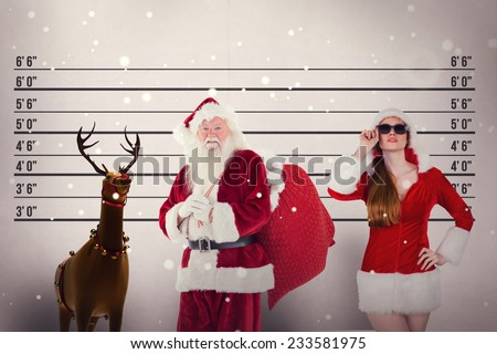 Santa carries his red bag against mug shot background - stock photo
