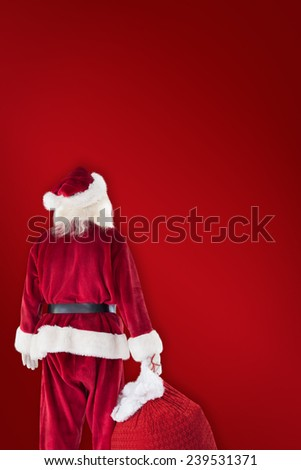 Santa carrying sack of gifts against red background - stock photo