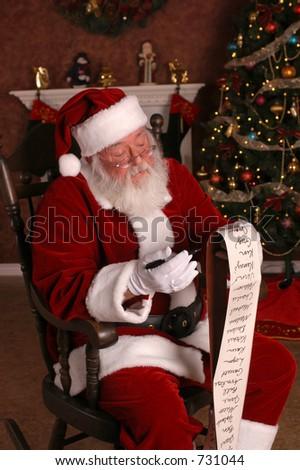 Santa Checks His List - stock photo