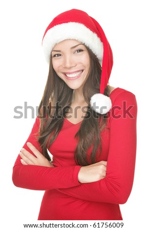 Santa christmas woman smiling portrait. Beautiful young woman in red wearing santa hat. Isolated on white background. Mixed asian / caucasian female model. - stock photo