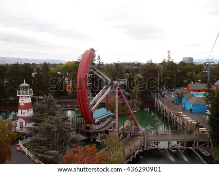 SANTA CLARA - AUGUST 7: Aerial view of Great America theme park featuring the Pirate ship ride swinging and a variety of shops on  August 7, 2010 Great America Park Santa Clara, California. - stock photo