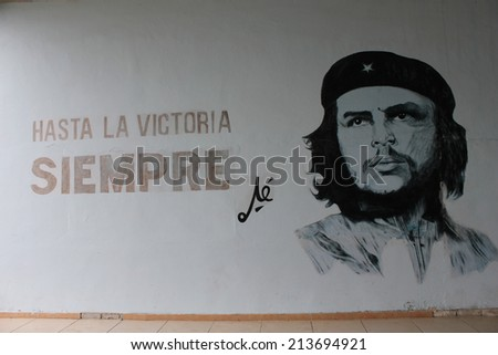 Santa Clara, Cuba, August 20, 2012: Cuba's politic propaganda. A wall script in favour of the revolution.Until Victory, forever, and Che Guevara Portrait - stock photo