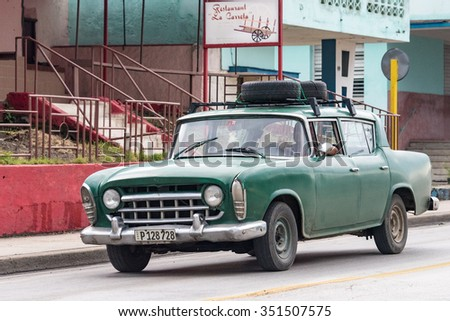 SANTA CLARA,CUBA-JULY 6,2015:Old vintage American car in Santa Clara used as taxi.Cuba has thousands of old classic American cars making them a major tourist attraction