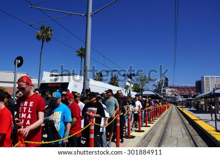 SANTA CLARA - MARCH 29:  Crowd of people de-board VTA transit train to attend Wrestlemania 31 at the Levi's Stadium in San Clara, California on March 29, 2015. - stock photo