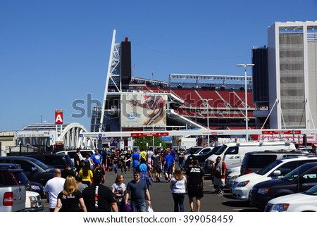 SANTA CLARA - MARCH 29: People walking through parking lot to arena before the  Wrestlemania 31, at the Levi's Stadium with Intel 49ers ad on side of building Santa Clara, California March 29, 2015. - stock photo