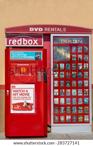 SANTA CLARITA, CA/USA - MAY 31, 2015: Redbox DVD rental machine. Redbox specializes in DVD, Blu-ray, and video game rentals via automated retail kiosks. - stock photo