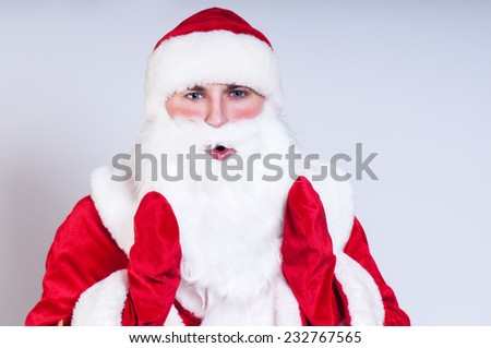 Santa Claus abstractly holds a gift - stock photo