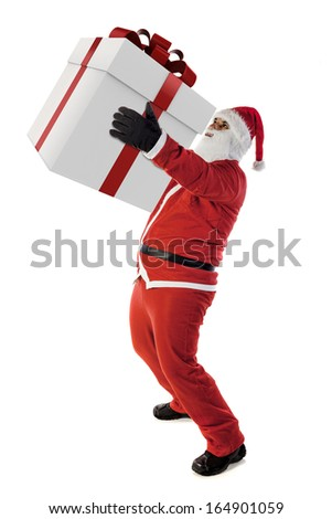 Santa Claus and a big present - stock photo