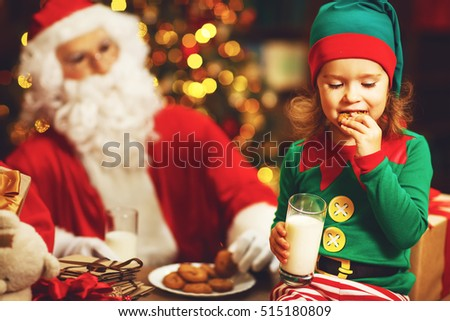 Santa Claus and a elf child in a Christmas drinking milk and eating cookies