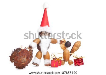 santa claus and angle tinkered with chestnuts and other on white background with copypsace - stock photo