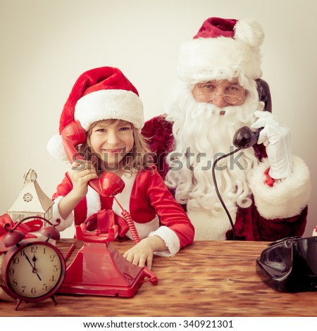 Santa Claus and child. Christmas holiday concept - stock photo
