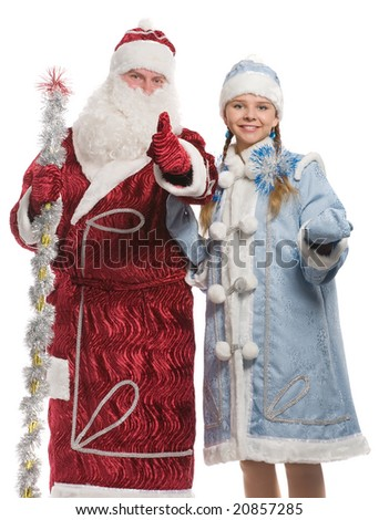 Santa Claus and snow maiden giving thumbs-up sign, isolated on white - stock photo