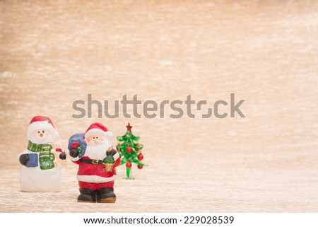 Santa Claus and snowman with fir tree - stock photo