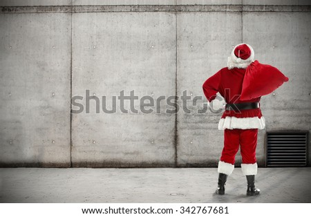santa claus and wall  - stock photo