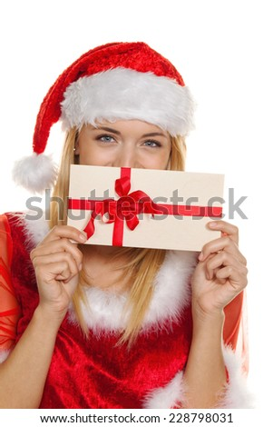 santa claus at christmas with a voucher for shopping