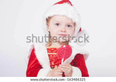 Santa Claus baby girl, studio shot - stock photo