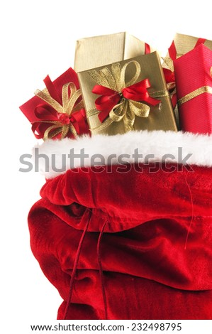 Santa Claus bag full of christmas presents, isolated on white background - stock photo