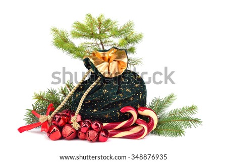 Santa Claus bag full of gifts with Christmas candy canes and Christmas green tree on white background - stock photo