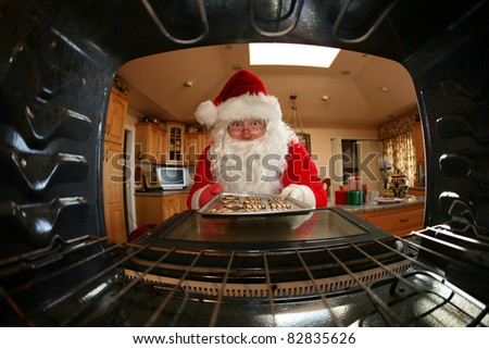 Santa Claus bakes cookies in his kitchen before christmas eve to share with his friends