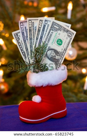 santa claus boot with money - stock photo