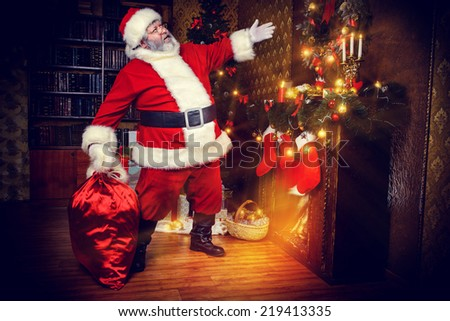 Santa Claus brought gifts for Christmas. Christmas home decoration. - stock photo