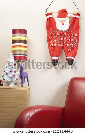 Santa Claus calendar hanging on white wall - stock photo