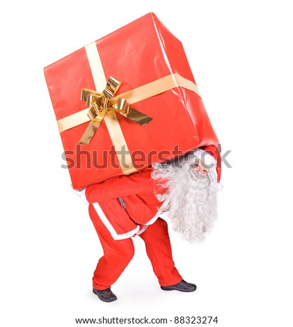 Santa Claus carries a big gift on white background - stock photo
