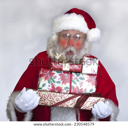Santa Claus - Christmas figure of Santa Claus with gifts - stock photo