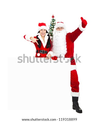 Santa Claus christmas girl hold white board hand show thumb up finger gesture, new year decorated tree with empty copy space for text, full length isolated on white background - stock photo