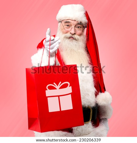Santa claus distributing gifts to all on Christmas eve - stock photo