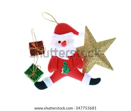 Santa Claus doll with christmas decorations isolated on white.Clipping path. - stock photo