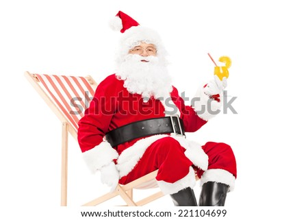 Santa Claus drinking a cocktail seated in a sun lounger isolated on white background - stock photo