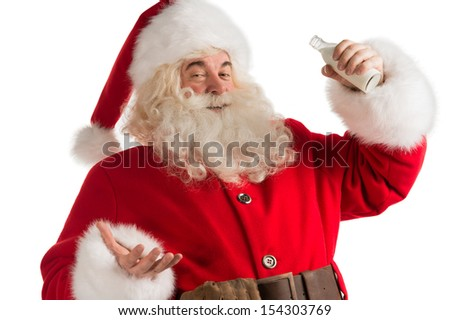 Santa Claus drinking milk from bottle isolated on white background. Healthy lifestyle promotion