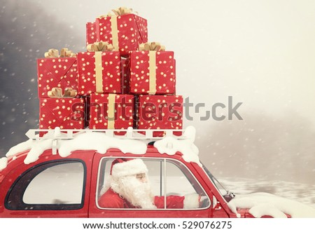 Santa Claus drives a red car full of Christmas present