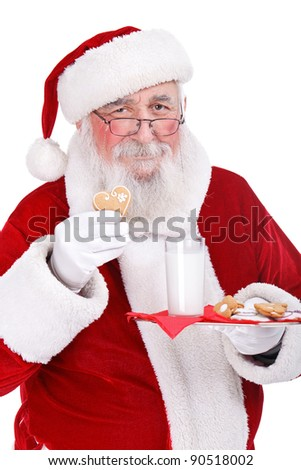 Santa Claus enjoys cookies and milk left out for him, on Christmas eve, isolated on white background - stock photo