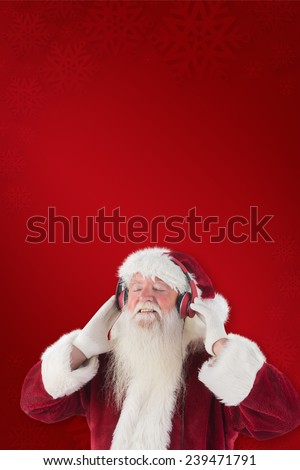Santa Claus enjoys some music against red background - stock photo
