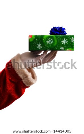Santa Claus Father Christmas hand with wrapping paper present and blue star ribbon decoration - stock photo