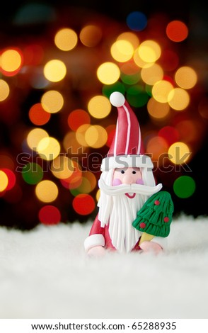 Santa Claus figurine against beautiful bokeh