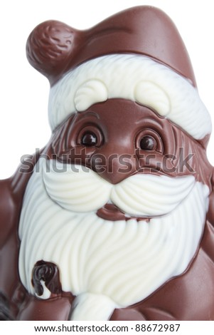 Santa Claus from the chocolate Christmas dessert - stock photo