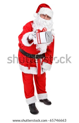 Santa claus gives a present on white background - stock photo