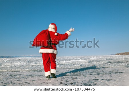 Santa Claus goes, the holiday is over,  shooting was conducted in a sunny day on lake Baikal - stock photo