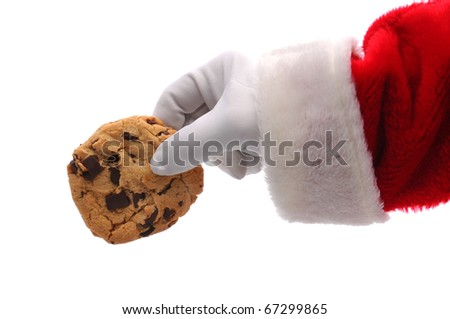 Santa Claus Hand holding a chocolate chip cookie over a white background. Horizontal format showing Santa's hand a arm only. - stock photo
