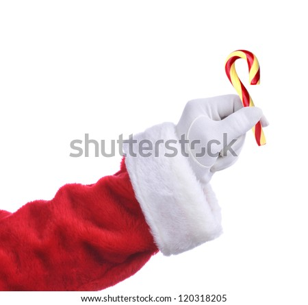 Santa Claus hand holding an Old Fashioned Candy Cane. Isolated on white, hand and arm only. - stock photo