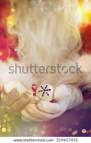 Santa Claus hand holding bell - stock photo