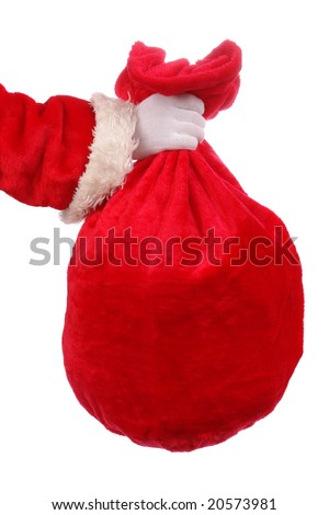 Santa Claus hand holding red sack full of presents over white background - stock photo