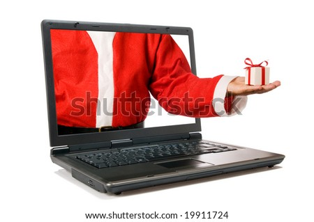 Santa Claus hand with a gift come out from a screen of a laptop computer isolated on white background. - stock photo