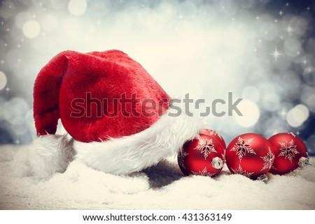 santa claus hat and xmas ball on snow  - stock photo